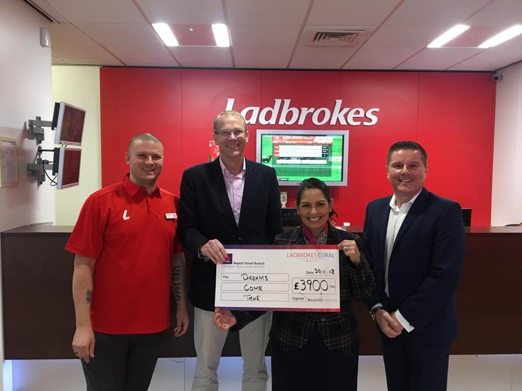 Priti Patel MP presents Charity Cheque