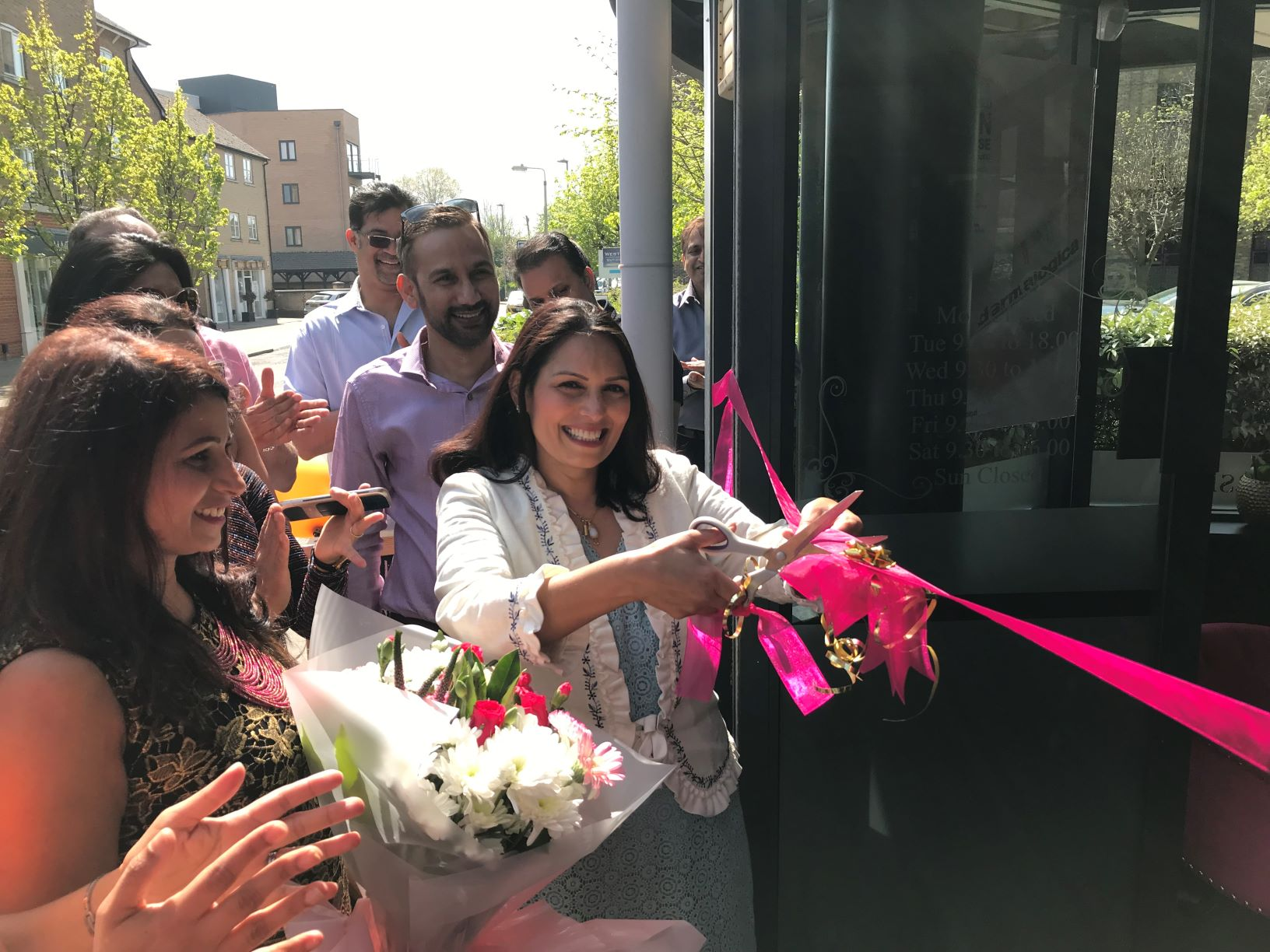 Priti Patel MP cutting the ribbon to declare the Luxe Studio open