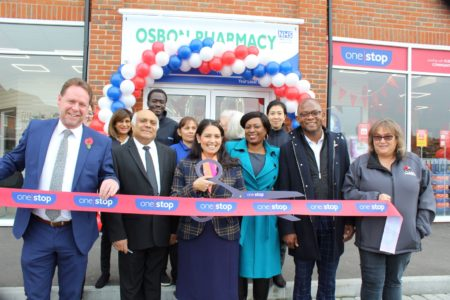 Priti Patel with staff from Osbon Chemists and the One Stop shop, officiating at the ribbon cutting ceremony