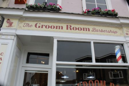 Views of The Groom Room Barbershop signage