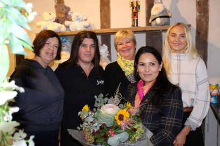 Priti Patel with staff and customers at Oakleys of Coggeshall receiving her bouquet