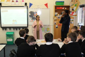 Priti addresses the students taking part in the Be Internet Citizens Workshop at Honywood Community Science School, Coggeshall.