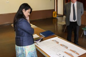 Priti studies the plans for the proposed new Tolleshunt D'arcy Village Hall