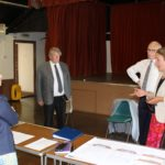Priti with (from left) Robert Morgan (Chairman), Charles Clark and Fiona Marshall from the Tolleshunt D'arcy Village Hall Trust, during her tour of the Village Hall at Tolleshunt D'arcy.
