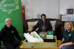 Jacqui Stone (left) and Wendy Bixby (right) of Abberton Rural Training showing Priti Patel the grow your own food starter pack.