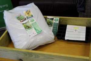 The starter pack, including a planter, a potting tray, a bag of compost and a selection of seed packets for vegetable and salad plants