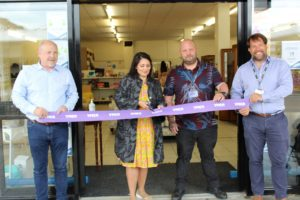 Left to right: Andy Smith YMCA Area Manager, Priti Patel MP, Darren Southall, YMCA Store Manager and Andy Smith YMCA Area Manager at the ribbon cutting ceremony.