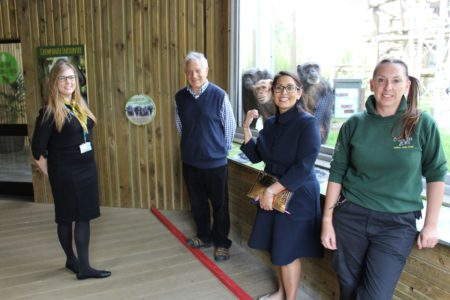 Left to right: Melissa Dench, Business Development Manager, Dominique Tropeano OBE, Zoo Director, Priti Patel MP with curious onlookers over her shoulder and Sarah Forsyth, Zoo Curator