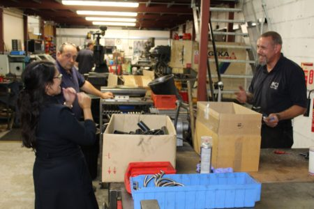 Priti Patel MP with Mick Johnson, owner and staff member, George Downes during her tour of MGJ Engineering's workshops