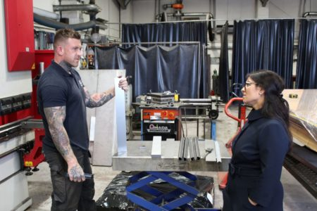 Priti Patel MP with MGJ Engineering staff member, Brett Crittenden during her tour of their workshops