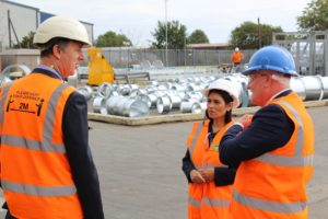 Priti Patel MP with General Manager, David Knight (left) and Steve Milnes Regional Director during her tour at South East Galvanizers.