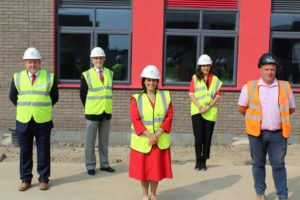 Priti Patel (centre) with left to right: Paul Banks, CEO of Chelmsford Learning Partnership, Cllr Ray Gooding, Essex CC Cabinet Member for Education & Learning, Koulla Anslow, Headteacher of Lakelands Primary School and Jason Grimble, Senior Site Manager for Barnes Contruction