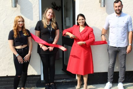Priti Patel cuts the ribbon to formally open the Matrix Hair & Beauty Academy with from left Academy team member Paris Sellick and owners, Natalie and Kyle Worster.