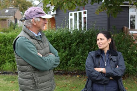 Ralph Hayter, owner of Daymens Hill Farm discusses the fruit business with Priti Patel during her tour of the orchards.