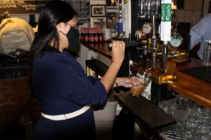 Priti pulls a pint during her visit to The Square and Compasses, Fairstead
