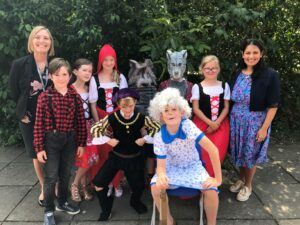 Priti visiting a school taking part in Get Witham Reading in 2019 (pre-Covid).