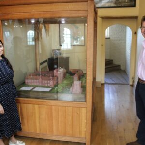 Priti Patel MP with Tower Trustee Nick Charrington and a scale model of Layer Marney Tower.