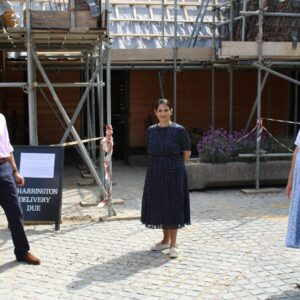 Priti Patel MP with Tower Trustees Nick & Sheila Charrington outside the Essex Barn, which is currently undergoing major restoration works.