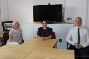 Priti Patel MP with Carolyn Gulleford (left) of the Purposeful Communication Programme for Autism and Adam Dean, Head Teacher designate of the Chatten Free School (right).