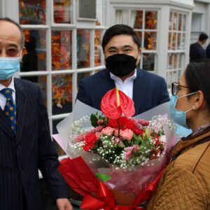 Priti gets a warm welcome from AKA Manager Kenny Wong (left) and owner Alex Lai, as she arrives at the new premises.