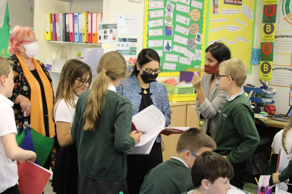 Priti visits Powers Hall Academy to chat with pupils about their handwriting and gardening