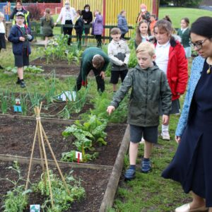 Priti visits the Powers Hall Academy allotments and gets a briefing from pupils about what they have been growing.