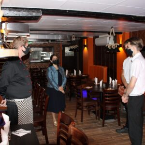 Priti chats with the staff at Flamin' Moe's Restaurant.