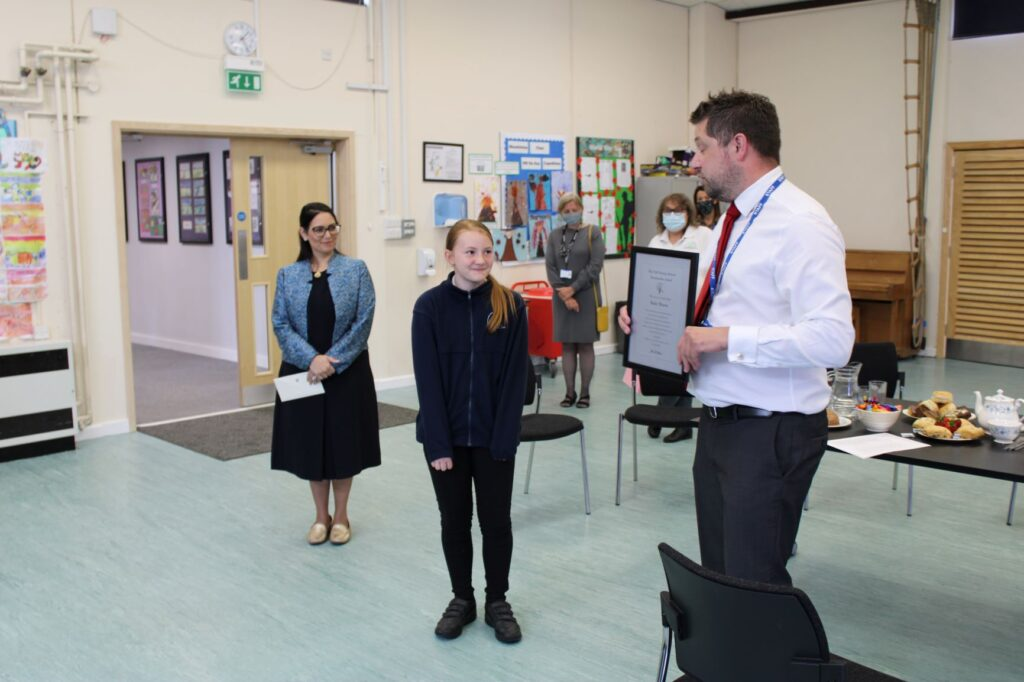 Priti Patel meets Elm Hall Primary School pupil to celebrate her prolific read of over 9 million words