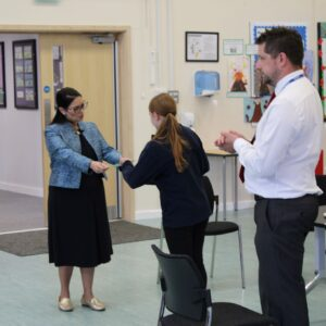 Priti Patel presents prolific reader, Katie Mason with a personal letter of commendation for reading 9 million words in an academic year.