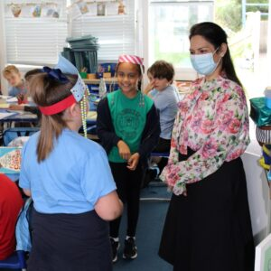 Pupils at Howbridge Primary School discuss the hats they have made for GWR 2021