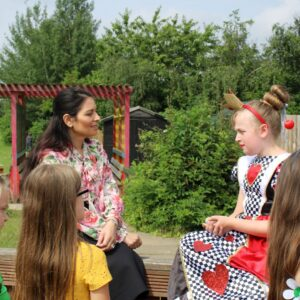 Priti Patel chats with pupils about Get Witham Reading at Powers Hall Academy.