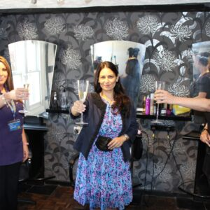 Priti Patel MP toasts 17 years in business with Finishing Touches proprietors, Zoe Chivers (left) and Hayley Jackson (right)